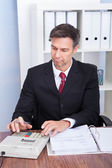 Businessman Calculating Invoice — Stock Photo