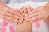 Woman's Feet Receiving Foot Massage — Stock Photo