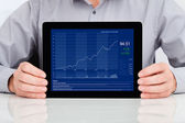 Businessman Showing Graph On Digital Tablet — Stock Photo