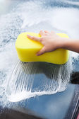 Hand Washing Windscreen With Yellow Sponge — Stock Photo