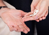 Hand Holding White Pills — Stock Photo