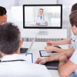 Stock Photo: Doctors Watching Online Presentation