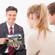 Agent With Tablet Pc Showing House To Couple — Foto Stock