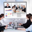 Businesspeople In Video Conference At Business Meeting — Stock Photo