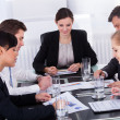 Businesspeople Sitting At Conference Table — Stock Photo