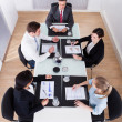 Businesspeople Sitting At Conference Table — Stock Photo #40089485