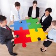 Businesspeople Assembling Jigsaw Puzzle — Stock Photo #40089879