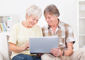 Senior Couple Looking At Laptop — Stock Photo
