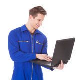 Young Male Technician Using Laptop — Stock Photo