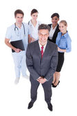 Businessman In Front Of Professional Workers — Stock Photo
