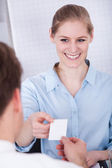 Happy Businesswoman Exchanging Visiting Card — Stock Photo