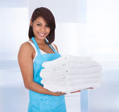 Smiling maid woman with towels — Stock Photo