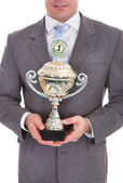 Businessman Holding Trophy — Stock Photo