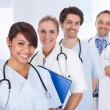 Group of doctors standing together over white — Stock Photo #40090445