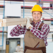 Repairman With Wooden Plank — Stock Photo