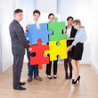 Businesspeople Assembling Jigsaw Puzzle — Stock Photo