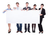 Businesspeople Holding Blank Board — Stock Photo