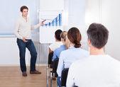 Man Explaining Graph — Stock Photo
