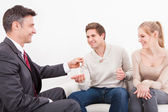 Couple With Real Estate Agent — Stock Photo