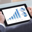 Businessman Analyzing Chart On Digital Tablet — Stock Photo