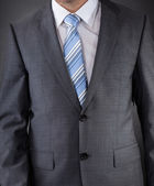 Man Dressed In Suit With Striped Tie — Stock Photo