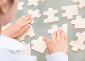 Businesswoman With Scattered Puzzle — Stock Photo
