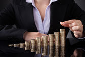 Businesswoman With Row Of Coins — Stock Photo