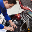 Mechanic Using Laptop While Repairing Car — ストック写真