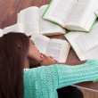 Female student sleeping with books at classroom desk — Foto de Stock