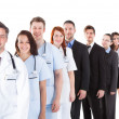 Doctors and managers standing in row — Stock Photo #43208157