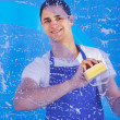 Male Servant Cleaning Glass With Sponge — Stock Photo
