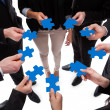 Business people connecting puzzle pieces — Stock Photo
