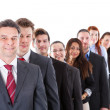 Business people standing in row — Stock Photo #43209305