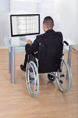 Businessman On Wheelchair Using Computer — Stock Photo