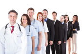 Doctors and managers standing in row — Stock Photo