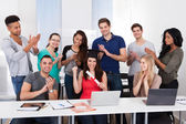 Students Clapping For Classmate Holding Degree — Stock Photo