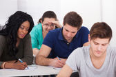 Female Students Trying To Cheat During Test — Stock Photo