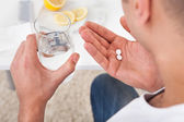 Sick Man Taking Tablets With Glass Of Water — Stock Photo