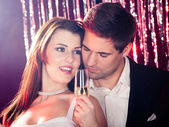 Couple Enjoying Champagne At Nightclub — Stockfoto