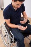 Man Holding Medicine While Sitting On Wheelchair — Stockfoto
