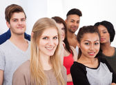 Portrait Of College Students Standing In Classroom — Stock Photo