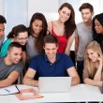 University Students Using Laptop Together — Stock Photo #43210623