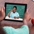 Teacher Assisting Student Through Video Conferencing — Stock Photo