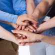 Group of people stacking hands together — Stock Photo #43211335