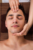 Man Receiving Head Massage From Massager In Spa — Stock Photo