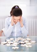 Businesswoman With Puzzle At Desk — Stock Photo
