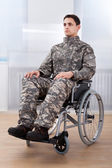 Patriotic Soldier Sitting On Wheel Chair — Stockfoto