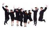 Happy rejoicing group of multiethnic graduates — Stock Photo