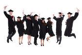 Happy rejoicing group of multiethnic graduates — Stock Photo