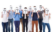 Diverse group of people holding question signs — Stock Photo